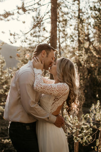 A couple kisses in the woods on their elopement day in Bend, Oregon