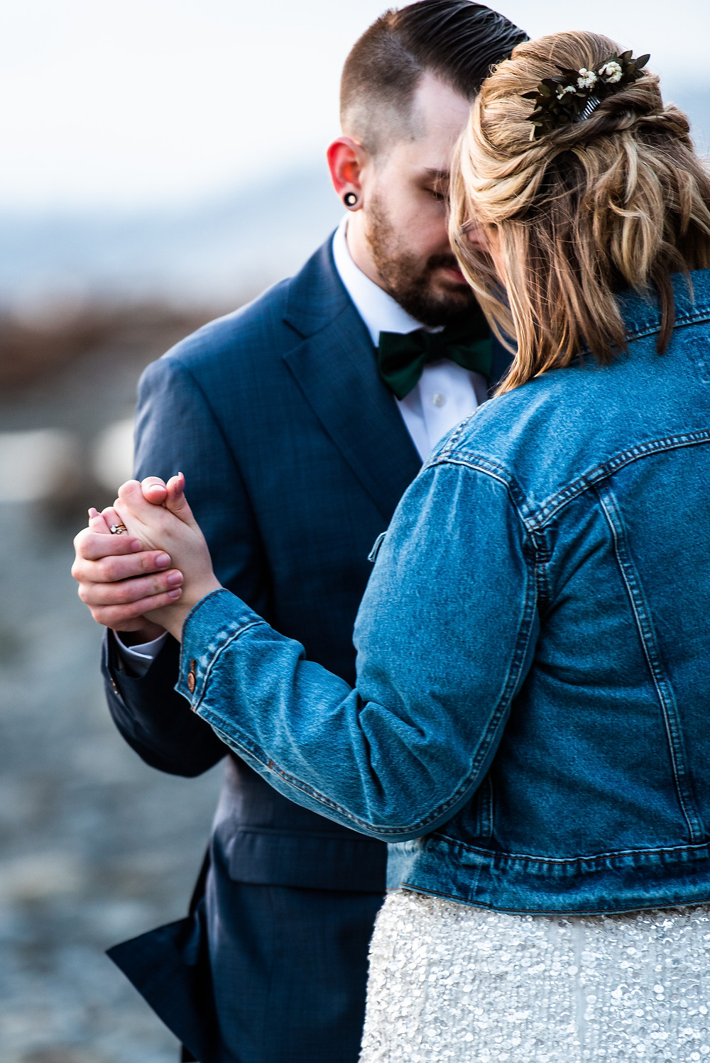 A couple sharing a private moment during their first dance on the beach during their Ruby Beach elopement