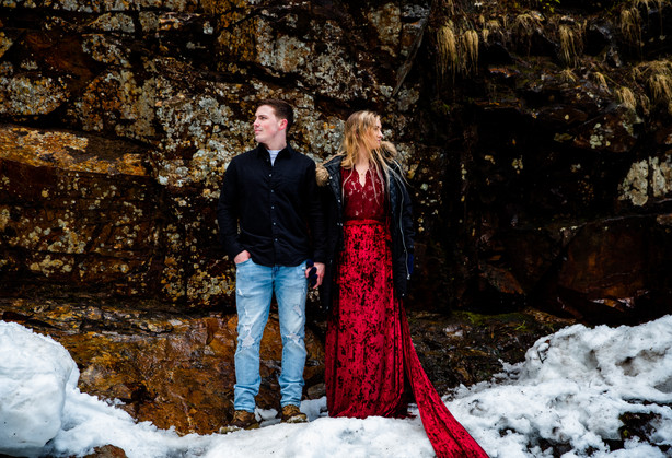A couple enjoys the scenery at Franklin Falls Washington during their engagement photos
