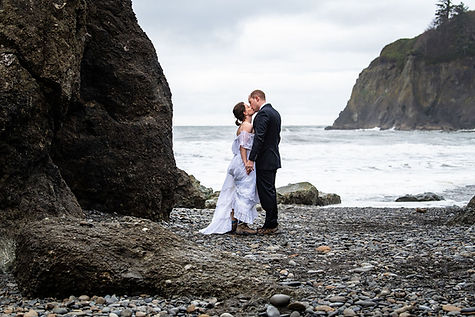 A couple kisses on Ruby Beach during their Olympic National Park adventure elopement