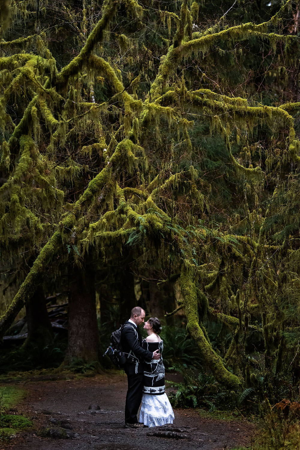 A couple cuddling and hugging during their Hoh Rainforest adventure elopement