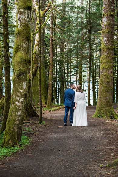 Olympic National Park Elopement at Lake Crescent, a couple kisses in the middle of a rainforest