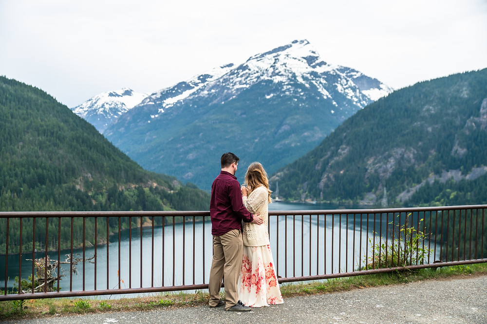 An elopement couple looks at the view during their Diablo Lake North Cascades elopeement