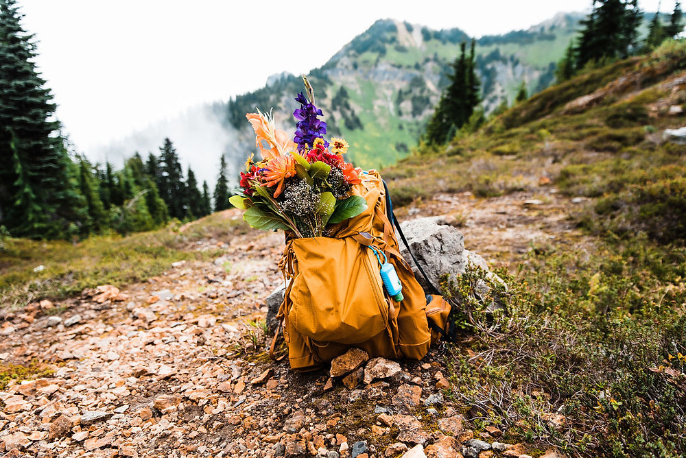 A bridal bouquet in a backpack at Mount Rainier