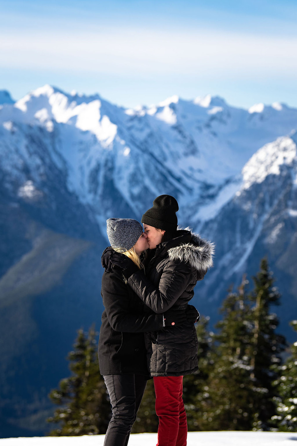 A couple kissing during their engagement photos on Hurricane Ridge in Olympic National Park