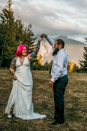 A couple shares their first dance after getting married at the top of a mountain in Washington and hiking on their elopement day