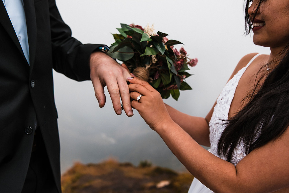 Rings are exchanged during this mountain adventure wedding in Washington near the North Cascades National Park