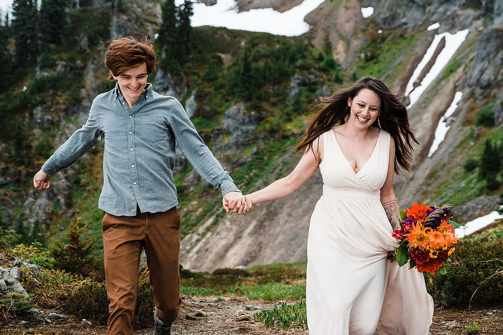 A couple running on their wedding day at Mount Rainier