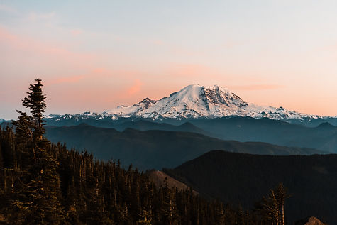 Mount Rainier at sunset as seen at a fire lookout in Washington