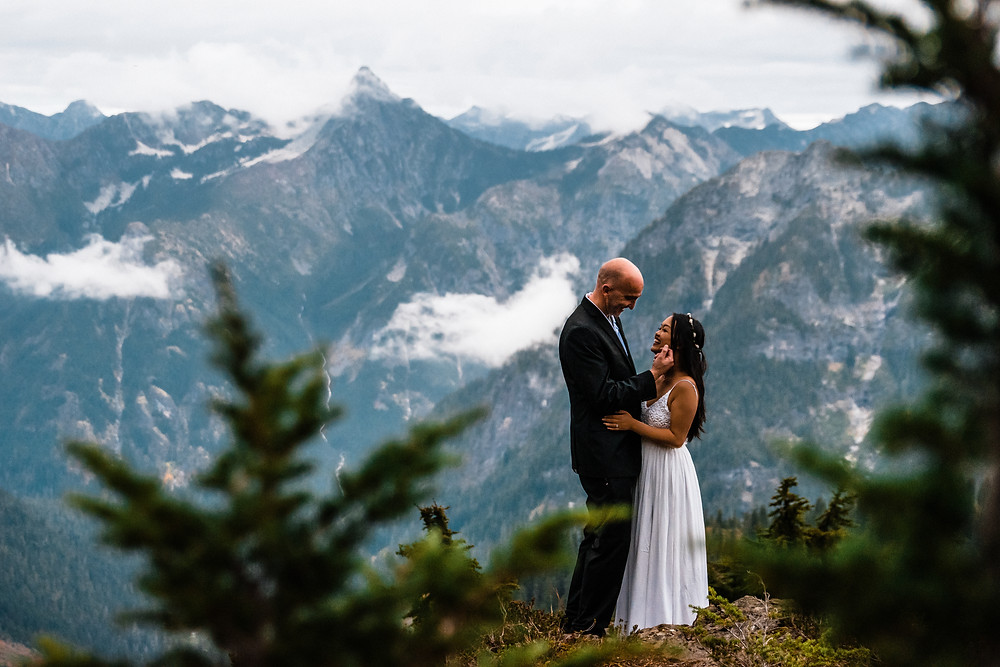 A bride and groom cuddling and enjoying their elopement day in the North Cascades/ Mount Baker area