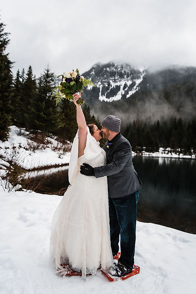 A couple about to kiss during their winter Gold Creek Pond elopement