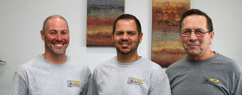 Owners Kevin Kleinschmidt and Jayme Gottch with company founder Jim Kleinschmidt of TJ Specialty Construction