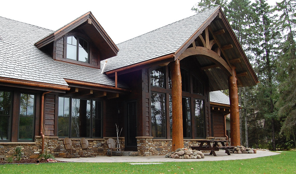 Custom built home on Gull Lake Nisswa MN craftsman style hand crafted details wooden beams and rafter tails log beams by TJ Specialty Construction