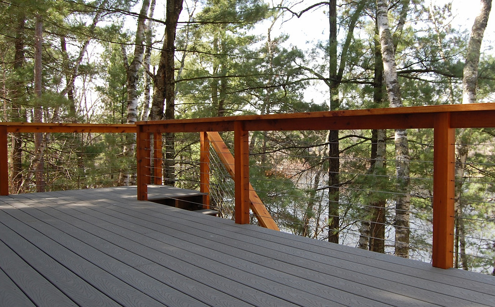Northwoods cabin composite deck with cable railing