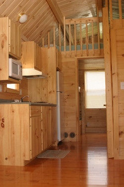 Kitchen. Bedroom in rear. Loft above