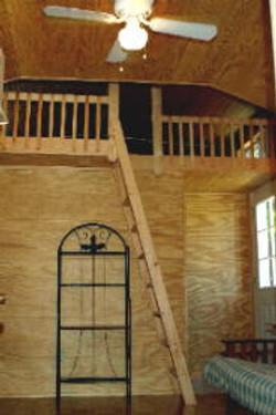 Ladder to loft. (NOTE: no futon)