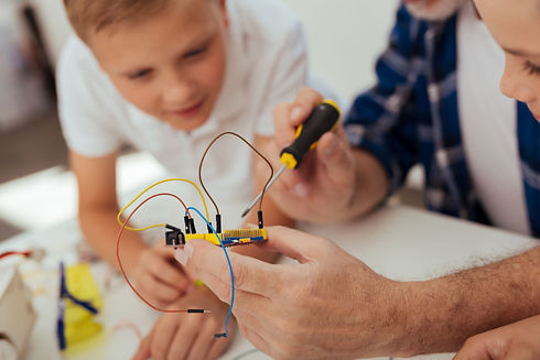digital-development-electronic-microscheme-with-wires-being-hands-nice-positive-man.jpg