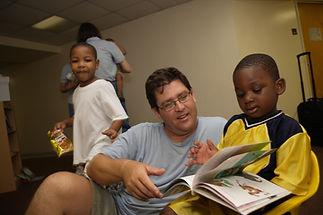 volunteer w kids.jpg
