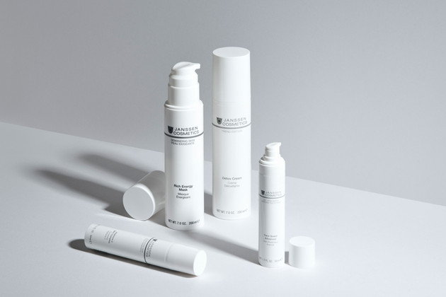White cream tubes by Janssen Cosmetics on a white background