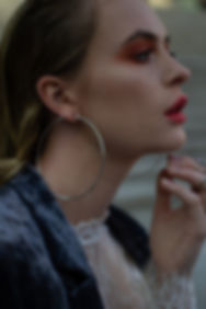 raw fashion photo with orange eye shadows and red lips
