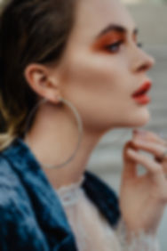 fully edited fashion photo with orange eye shadows and red lips with a colour correction
