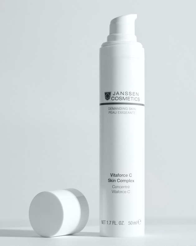 White cream tube by Janssen Cosmetics on a white background