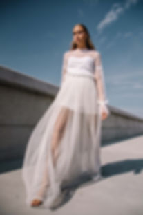 Fashion photographer in Estonia - a girls wearing a white dress on a blue and gray backdrop