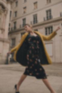 Fashion shoot in Milan - girl walking on heels wearing dress and a coat