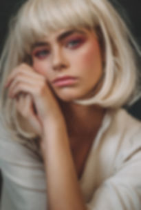 Fashion shoot: model in a white wig and pink eyeshadows