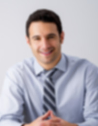 Man Sitting with a Tie