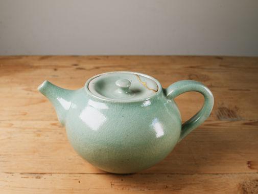 Small teapot with kintsugi repair.