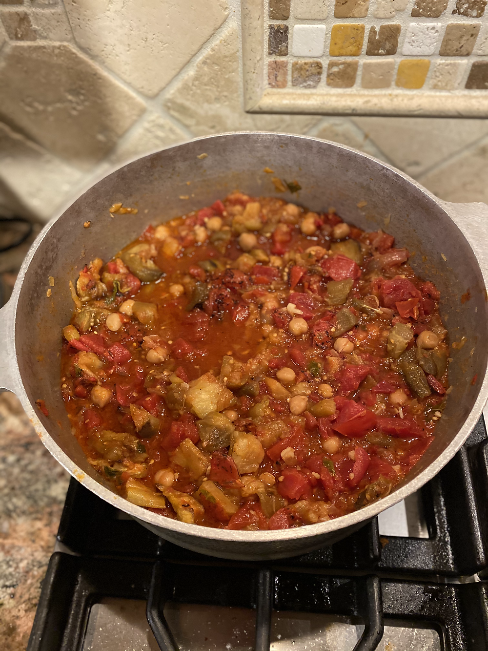 large pot of maghmour simmering on stovetop