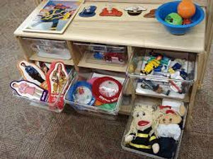 reading activities such as puppets, cut-out dolls, action figures etc.