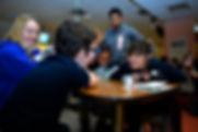 young people talking around a table