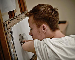 Boy drawing on an easel