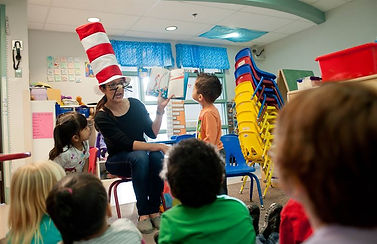 woman reading The Cat in the Hat to children
