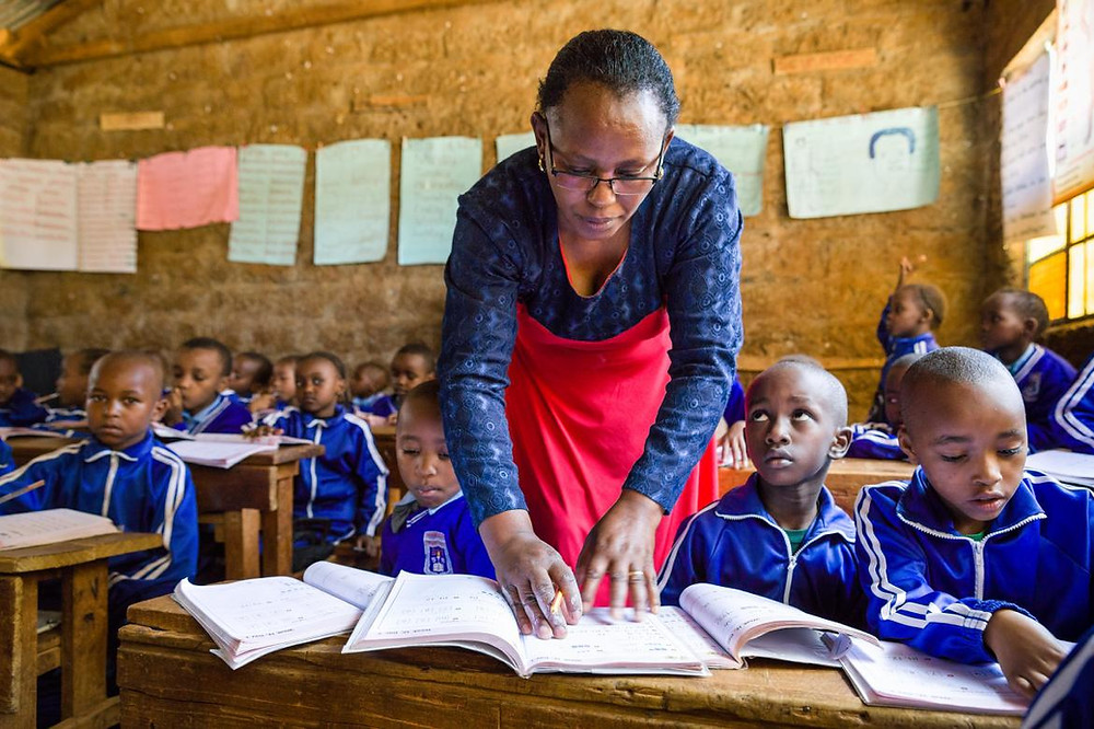 A teacher in class with her first-grade students at the Nyamachaki Primary School, Nyeri County in Kenya.