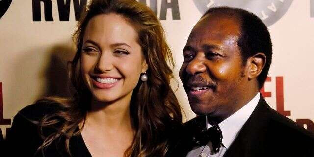 """In this Thursday, Dec. 2, 2004 ,file photo, Paul Rusesabagina, the inspiration for the film """"Hotel Rwanda,"""" poses with actress Angelina Jolie at the premiere of the film at the Academy of Motion Picture Arts & Sciences in Beverly Hills, Calif. (AP Photo/Chris Pizzello, File)"""