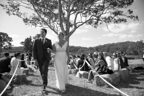 Country style wedding bride and groom walking down the aisle