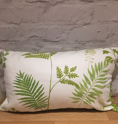 Evergreen rectangular pompom cushion