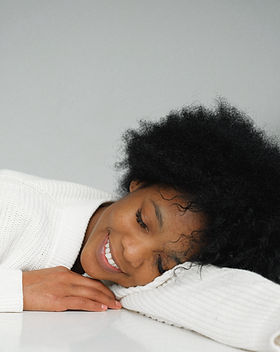 dreaming-charming-black-woman-leaning-on