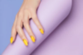 Nails Design. Hands With Bright Yellow M