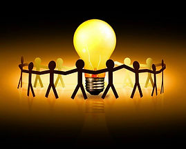 Holding hands around a light bulb collec