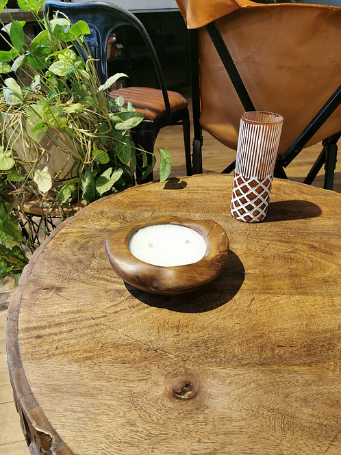 Candle in wooden bowl
