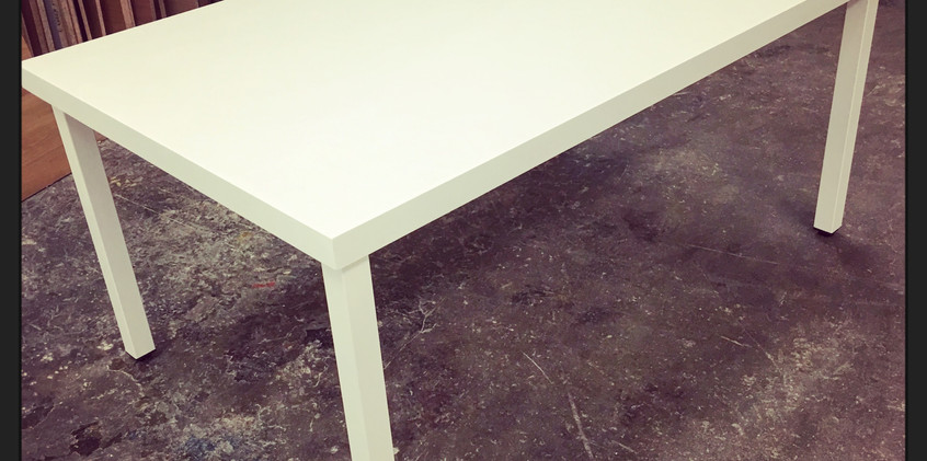 Colorcore table with steel frame.