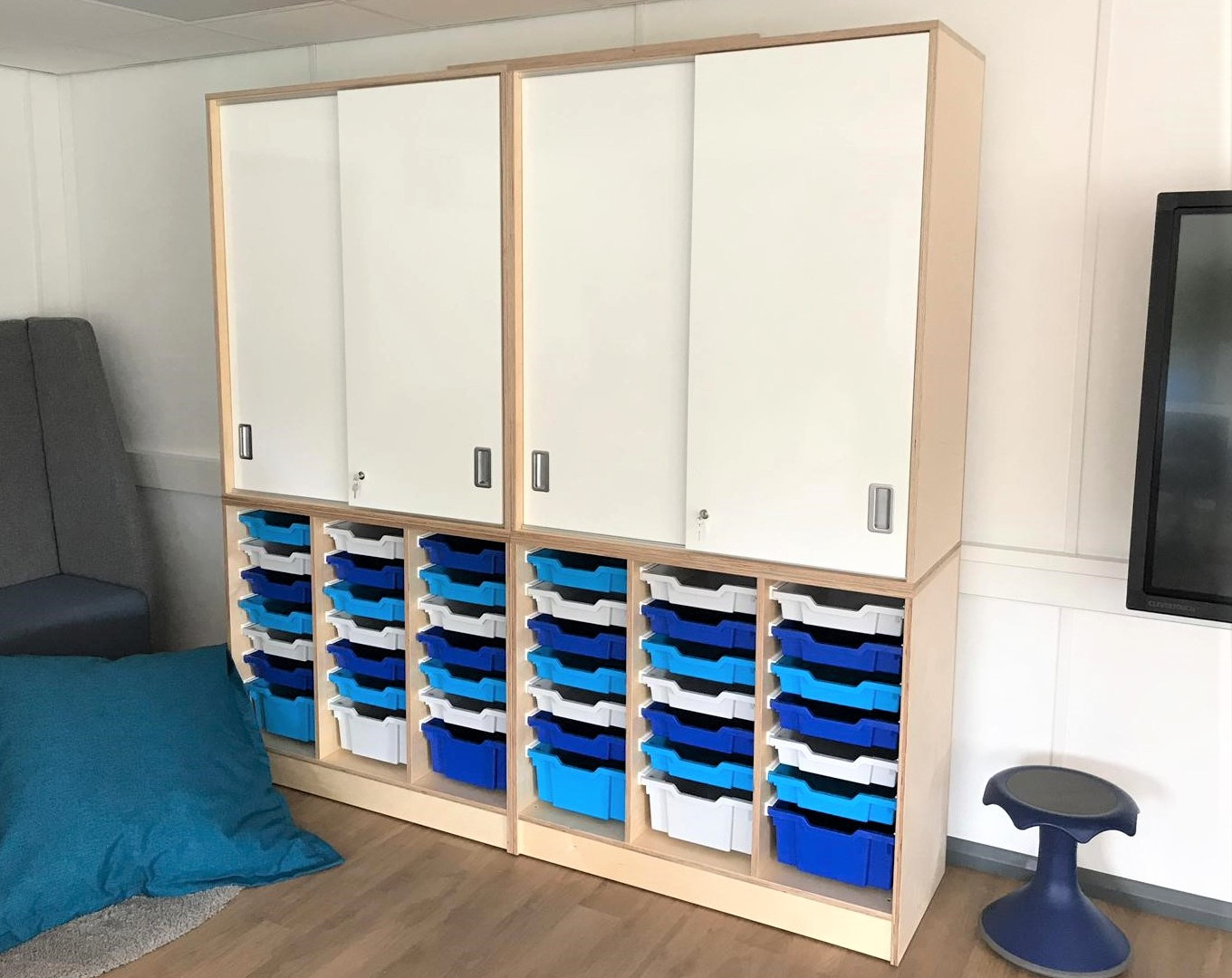 Classroom storage with whiteboard doors.