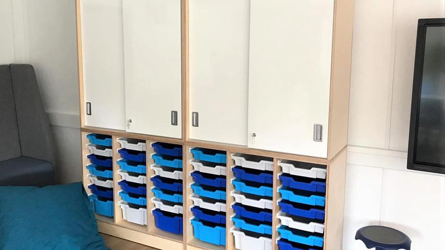 Classroom storage with whiteboard doors.