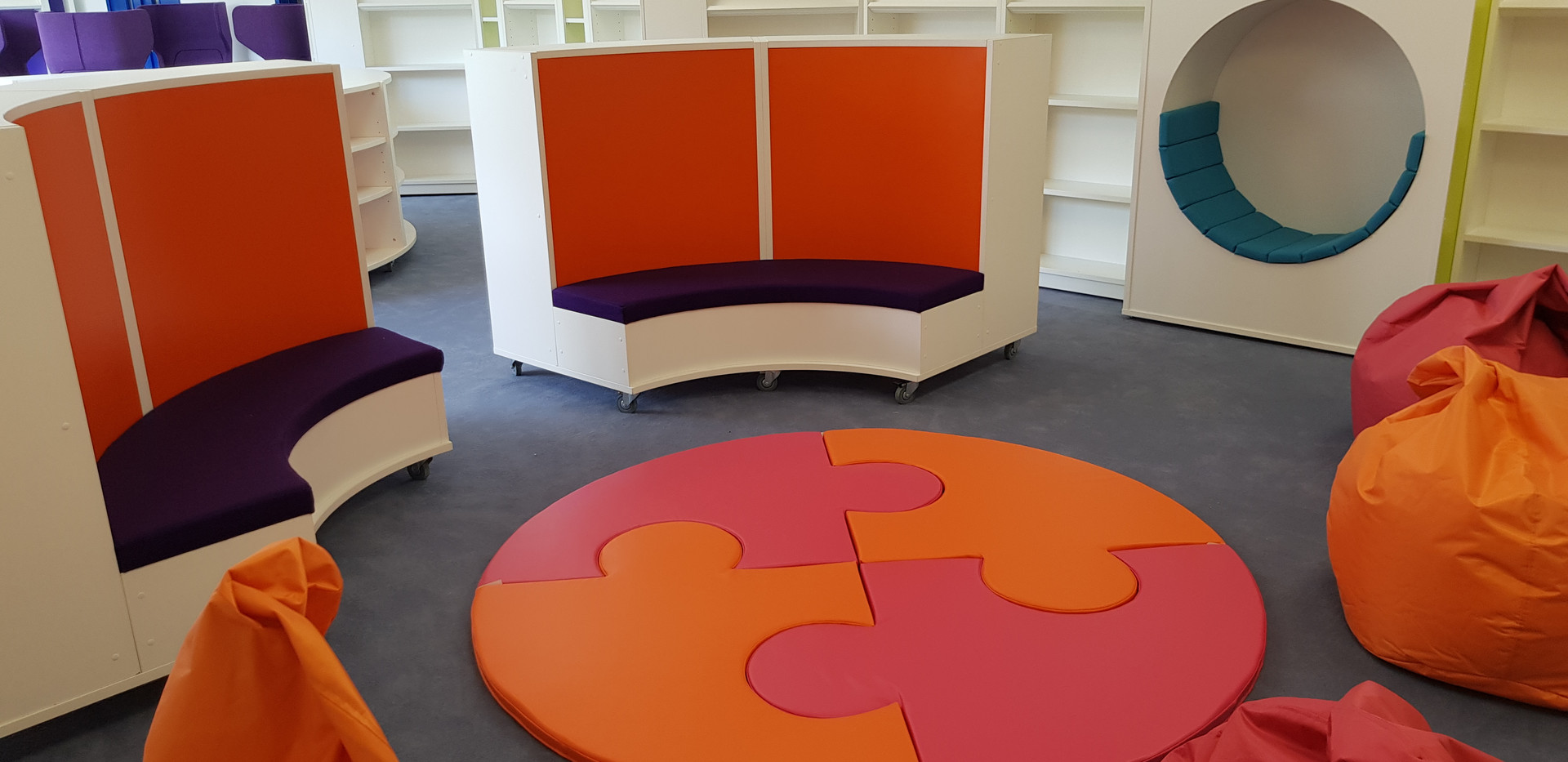 Bespoke library shelving with seating.