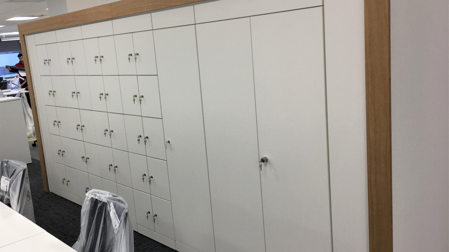 Alcove fitted storage and lockers.