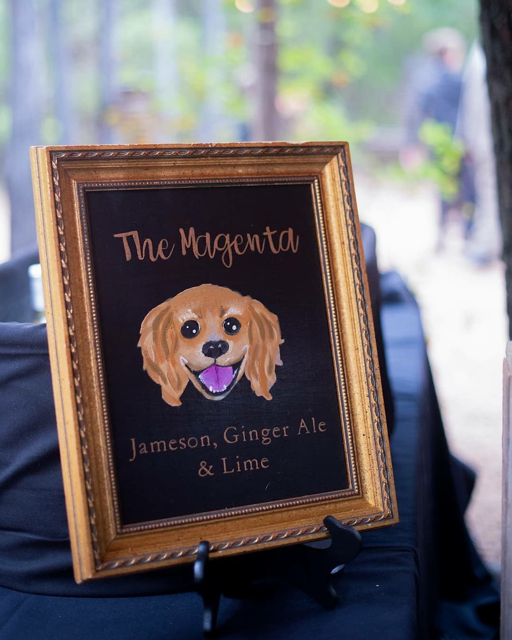 Wedding signature drink, painting of dog in a picture frame